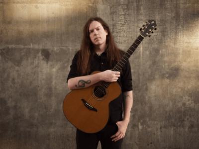 frontman Adrian with Furch guitar